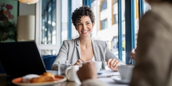 Young woman at a business lunch.