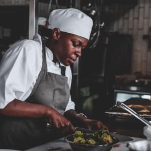 Chef (African American) preparing food.