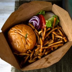 A boxed lunch containing a hamburger and French fries.