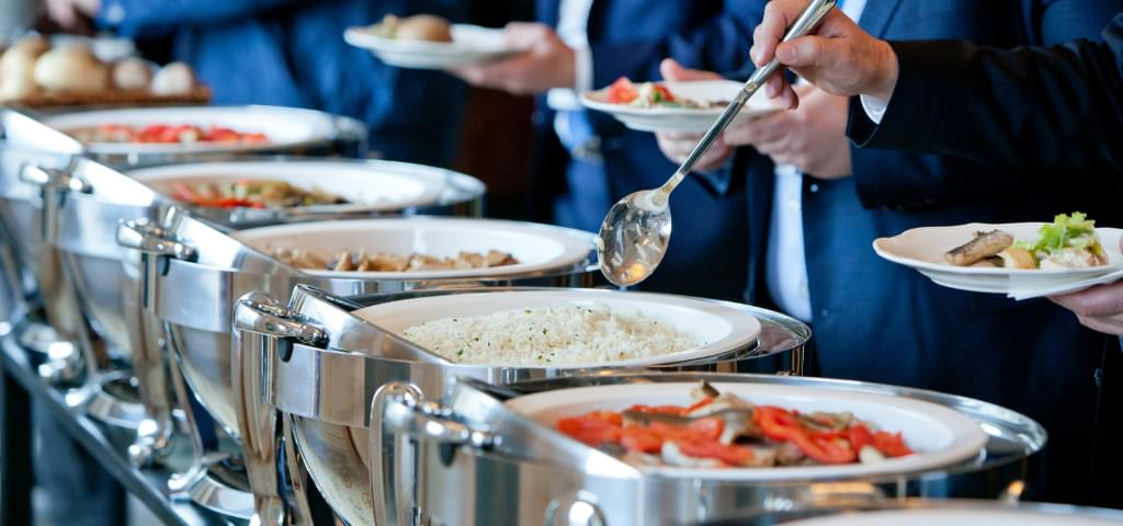 Food at a buffet line.