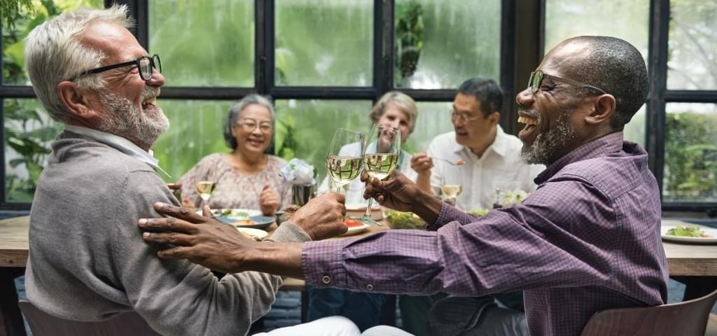 Multiracial group enjoying a meal.