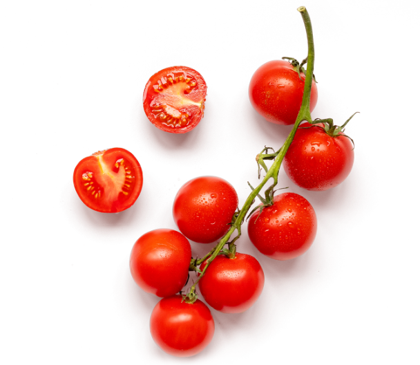 Cherry tomatoes on the stem and sliced.